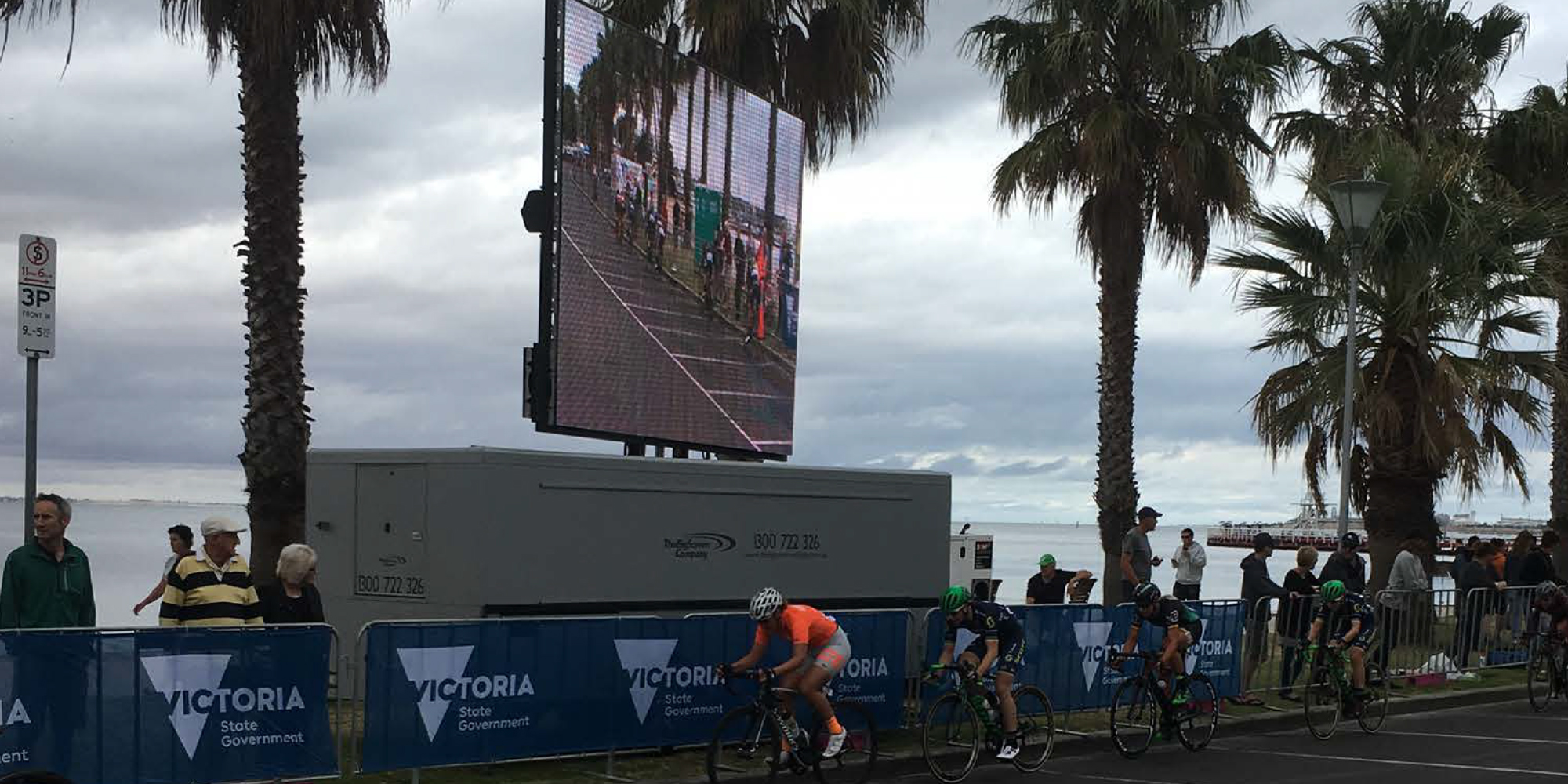 large mobile LCD display along side road with cyclist riding by