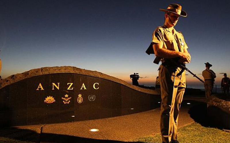 Anzac day memorial with soldier standing guard